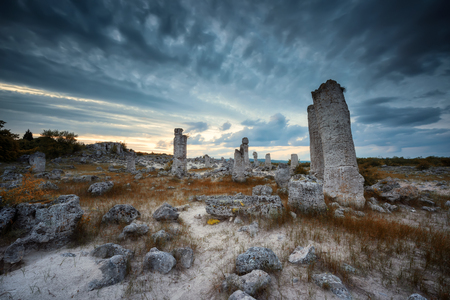 Stone Forest.  Beautiful sunset view with the famous rock formation Stone Forest near Varna, Bulgaria. Stock Photo