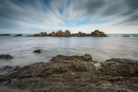 over the edge: Sea rocks. Long exposure day view of a rock formation near Varvara, Bulgaria.