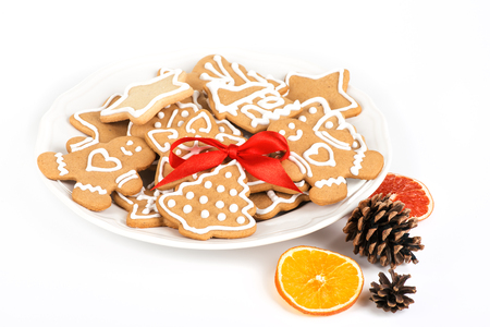 Christmas cookies with decoration  Still life with decorated Christmas cookies in a plate isolated on white