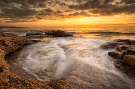 Rocky sunrise / A beautiful view with first rays at a rocky Black Sea coast, Bulgaria Archivio Fotografico - 111094286