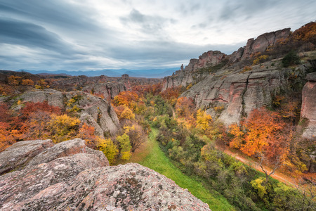 Magnificent morning view of the Belogradchik rocks in Bulgaria, lit by the autumn sun Фото со стока