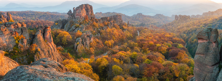 Magnificent panoramic sunset view of the Belogradchik rocks in Bulgaria, lit by the last rays of autumn sun Stock Photo