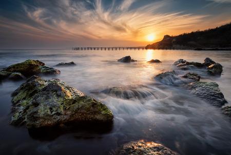 Rocky beach long exposure sea sunset
