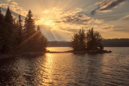 Golden lake sunset in Rhodope Mountains, Bulgaria Фото со стока