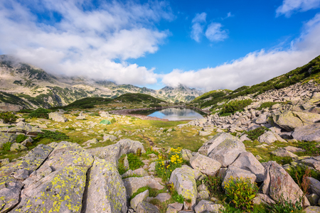 Magnificent summer view of the Frog lake in Pirin Mountains Фото со стока