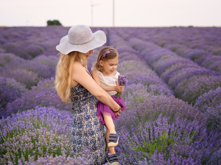 Woman and girl enjoying a lavender field view