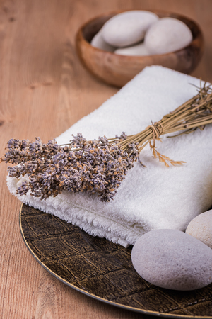 Spa decoration with candles, towels and dry lavender Archivio Fotografico - 109557017