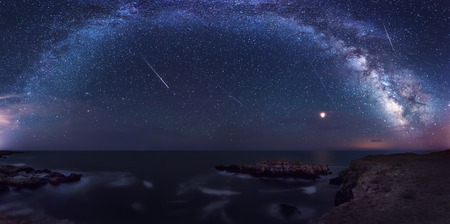 Long time exposure night landscape with planet Mars and Milky Way Galaxy during the Perseids flow above the Black sea, Bulgaria Фото со стока