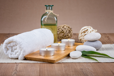 Spa decoration with candles, towels and stones