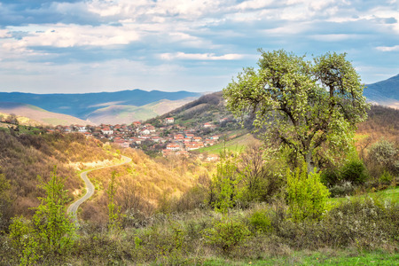 Amazing spring view with a little village in Rhodopi Mountains, Bulgaria Фото со стока
