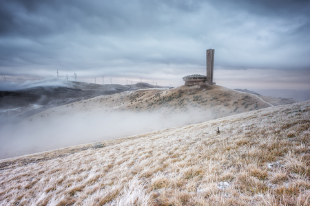 Winter landscape with abandoned Buzludzha monument and the frosty foggy peaks of Balkan Mountains, Bulgaria Фото со стока