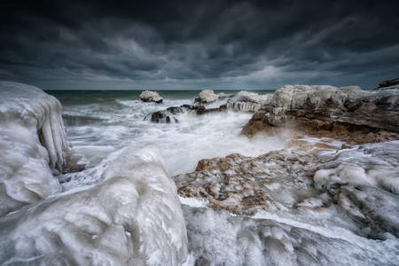 Magnificent morning view of the rocky coastline of  winter Black sea Archivio Fotografico - 118435794