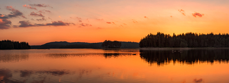 Panoramic view with golden lake sunset in Rhodope Mountains, Bulgaria Archivio Fotografico - 118435798