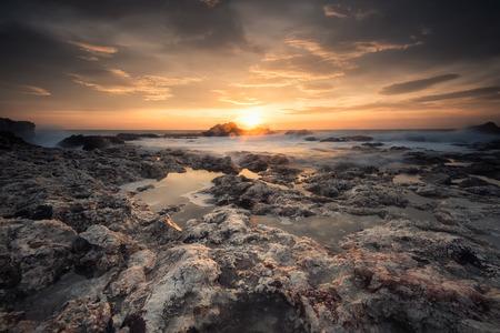 Magnificent sea sunrise at the rocky Black sea coast Фото со стока - 118435765