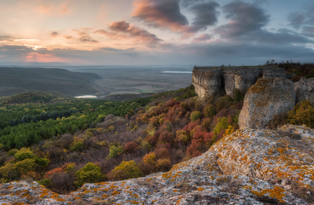 Amazing sunset view with rocks and autumn forest 写真素材 - 126045639