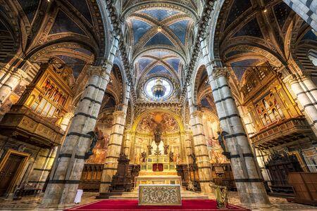 Siena, Italy - April 9, 2019: Panoramic view of interior of medieval Siena Cathedral (Duomo di Siena)  in Siena
