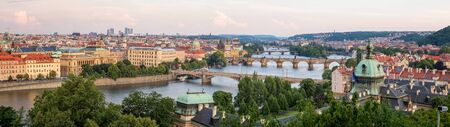 PRAGUE, CZECH REPUBLIC - JULY 5, 2017: Aerial panoramic view of famous bridges in Old Town of Prague in Czech Republic over Vltava river before the sunset. 報道画像