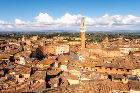 Panoramic view of Siena city in Italy with Piazza del Campo and the Torre del Mangia