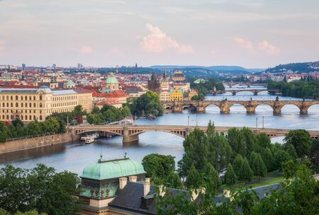 Aerial view of famous bridges in Old Town of Prague in Czech Republic over Vltava river before the sunset. 写真素材