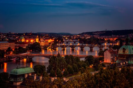 Aerial night view of famous bridges in Old Town of Prague in Czech Republic over Vltava river