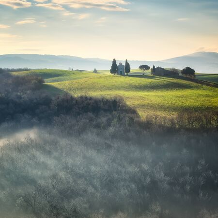 Beautiful morning view of the green spring fields in Tuscany and well known Vitaleta chapel near Pienza
