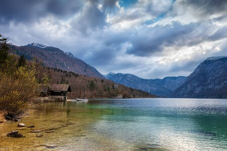 Panoramic spring view of Bohinj lake, located within the Bohinj Valley of the Julian Alps, Slovenia.