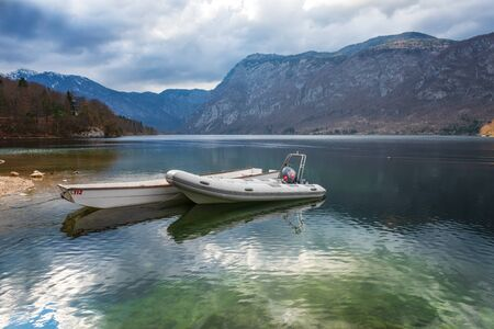Panoramic view with lifeboats at Bohinj lake, located within the Bohinj Valley of the Julian Alps, Slovenia.