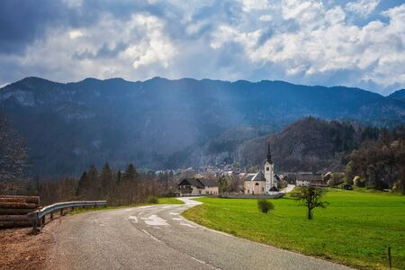 Scenic view of mountain village lit by spring sun in Slovenian Alps