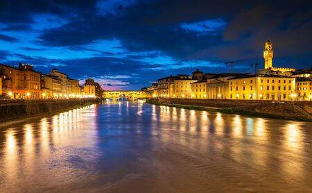 Panoramic night view of famous Ponte Vecchio over Arno River in Florence, Italy. 写真素材