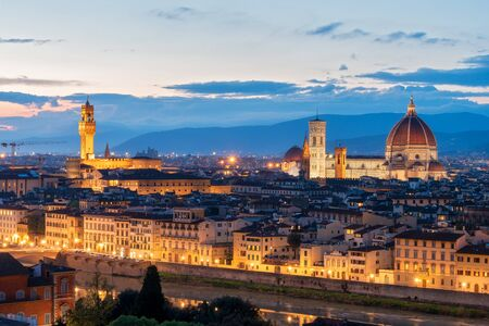 Amazing night view of Florence city, Italy with Palazzo Vecchio and Cathedral of Santa Maria del Fiore.  写真素材