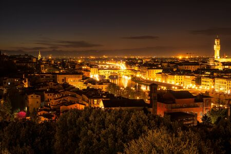 Amazing panoramic night view of Florence city, Italy with the river Arno, Ponte Vecchio and Palazzo Vecchio.