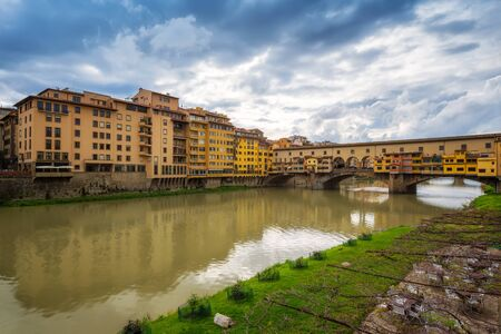 Panoramic day view of famous Ponte Vecchio over Arno River in Florence, Italy.
