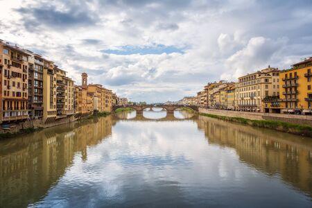Panoramic day view of Ponte Santa Trinita (Holy Trinity Bridge) over Arno River in Florence, Italy.