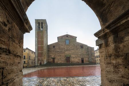 Rainy view of empty medieval Piazza Grande - main square in Montepulciano, Italy with Cathedral of Santa Maria Assunta 写真素材