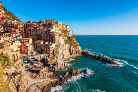 Panoramic view of beautiful town of Manarola - one of five famous colorful villages of Cinque Terre National Park in Italy, Liguria region. 写真素材