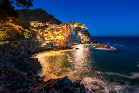 Panoramic night view of beautiful town of Manarola - one of five famous colorful villages of Cinque Terre National Park in Italy, Liguria region.