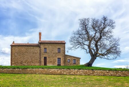 Amazing spring landscape with typical old stone house in Tuscany, Italy 写真素材
