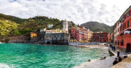 Vernazza, Italy - April 5, 2019: Beautiful view of Vernazza - one of five famous colorful villages of Cinque Terre National Park in Italy, Liguria region.