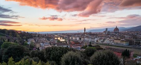 Amazing colorful sunset view of Florence city, Italy with the river Arno and Cathedral of Santa Maria del Fiore.