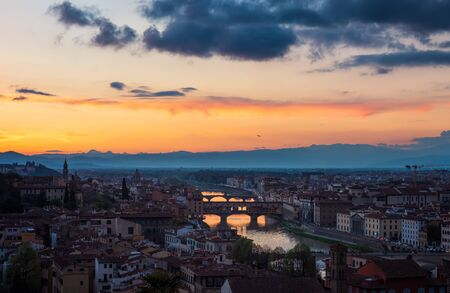 Amazing panoramic night view of Florence city, Italy with the river Arno and Ponte Vecchio.