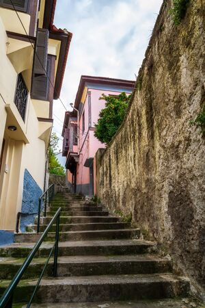 A narrow walkway with stairs in the old town of Kavala, northern Greece