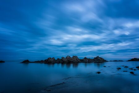 Amazing long exposure seascape with beautiful rock formation near the south rocky coastline of the Black Sea in the blue hour before sunrise