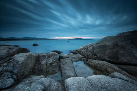 Long exposure seascape in the blue hour before sunrise
