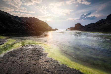 Magnificent sea sunrise at a rocky coastline, Black sea coast, Bulgaria 免版税图像