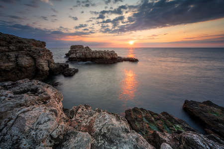 Amazing view with colorful sunrise sky at the rocky coastline of the Black Sea