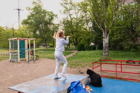 Little girl dancing on a tennis table