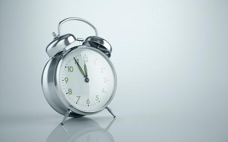puntualidad: Vintage metal reflective alarm clock background. Its ten to twelve, clock ticking