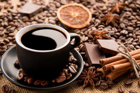 Yin and Yang in a Coffee cup on a saucepan with barley, cinnamon and chocolate