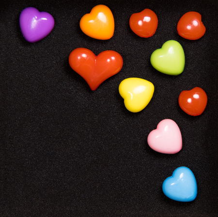 colorful hearts on a black background with a place for the inscription