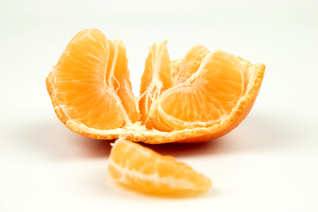 The tangerine is refined on a white background with copyspace
